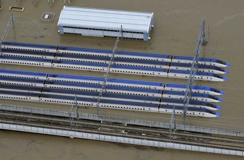 Rows of Japan's bullet trains, parked in a facility, sit in a pool of water in Nagano, central Japan, after Typhoon Hagibis hit the city, Oct. 13, 2019. (Photo: Yohei Kanasashi/Kyodo News via AP)