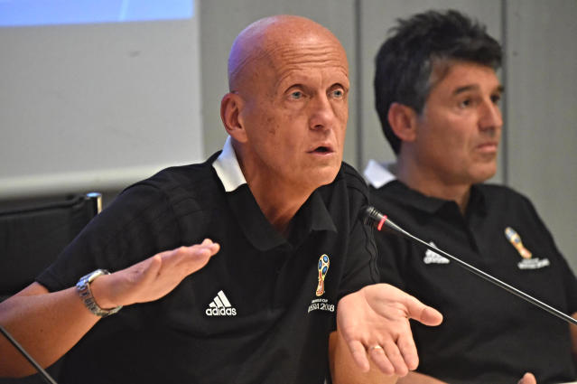 UEFA chief refereeing officer Pierluigi Collina, left, is flanked by FIFA head of refereeing Massimo Busacca as he talks during a meeting to explain how the VAR (Video assistant referee) will be used at the World Cup, at the Coverciano sports center, near Florence, Italy, Wednesday, April 18, 2018. (Maurizio Degl'Innocenti/ANSA via AP)