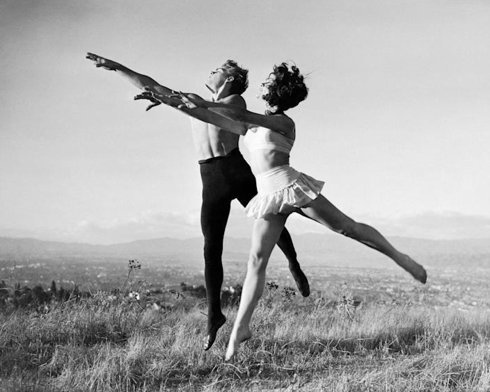 <p>Dean was a skilled dancer and is seen here practicing ballet with a woman in California. The actor had previously taken lessons in New York City. </p>
