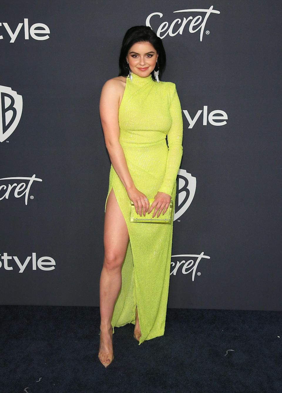 Ariel showed up to a Golden Globes afterparty in this asymmetrical, neon dress that was covered in sequins. The subdues texture of the garment makes for an added detail and Ariel took it to the next level with a matching purse and some transparent heels.