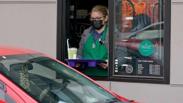 PHOTO: In this Oct. 27, 2020, file photo, a barista serves up a drink in the drive-through lane at a Starbucks Coffee store in south Seattle. (Ted S. Warren/AP, FILE)