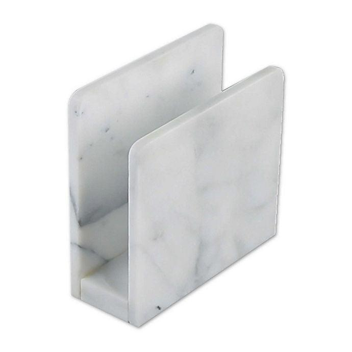 <p>This <span>Artisanal Kitchen Supply Marble Napkin Holder</span> ($15) will keep all your napkins or kitchen towels in order.</p>