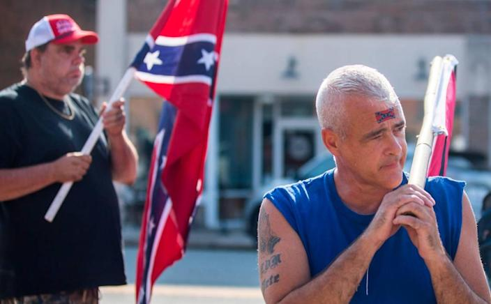 Joey Wardwell, left, and Thomas May, right, counter-protest a demonstration in Graham, N.C. on Saturday morning, July 10, 2021, in which demonstrators demanded the full release of Graham police body camera footage from an October 2020 march to the polls.