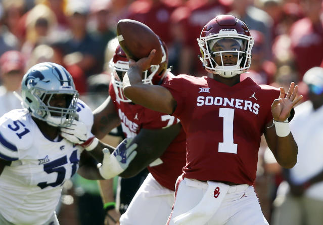 FILE - In this Oct. 27, 2018, file photo, Oklahoma quarterback Kyler Murray (1) throws in front of Kansas State defensive end Reggie Walker (51) in the first half of an NCAA college football game in Norman, Okla. Murray trusts Oklahoma coach Lincoln Rileys Air Raid system and the players in it. (AP Photo/Sue Ogrocki, File)