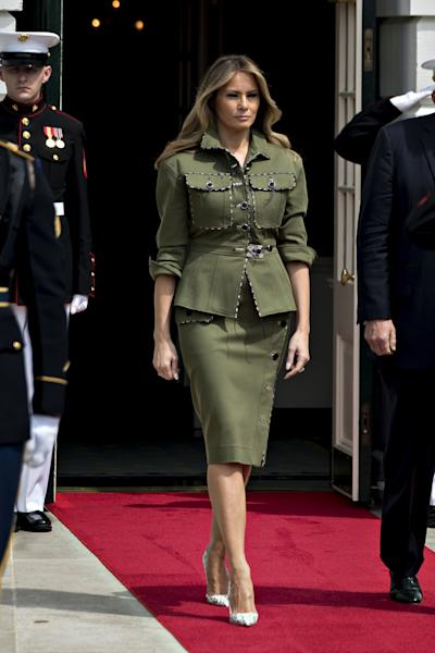 The First Lady stepped out in a military-inspired skirtsuit, one day after her birthday.