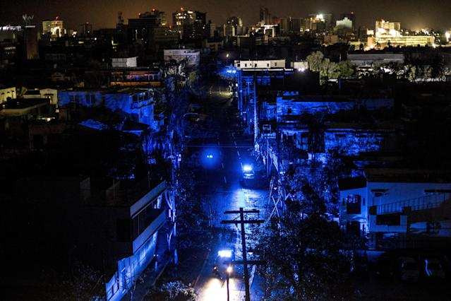 <p>San Juan is seen during a blackout after Hurricane Maria made landfall on Sept. 20, 2017 in Puerto Rico. (Photo: Alex Wroblewski/Getty Images) </p>