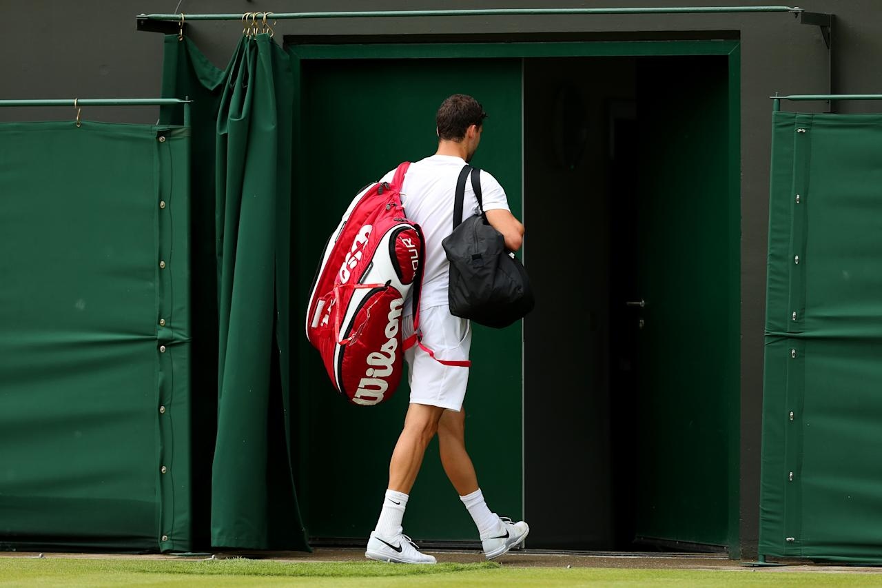 LONDON, ENGLAND - JUNE 28: Grigor Dimitrov of Bulgaria walks off court following his defeat to Greg Zemlja of Slovenia during their Gentlemen's Singles second round match on day five of the Wimbledon Lawn Tennis Championships at the All England Lawn Tennis and Croquet Club on June 28, 2013 in London, England. (Photo by Clive Brunskill/Getty Images)