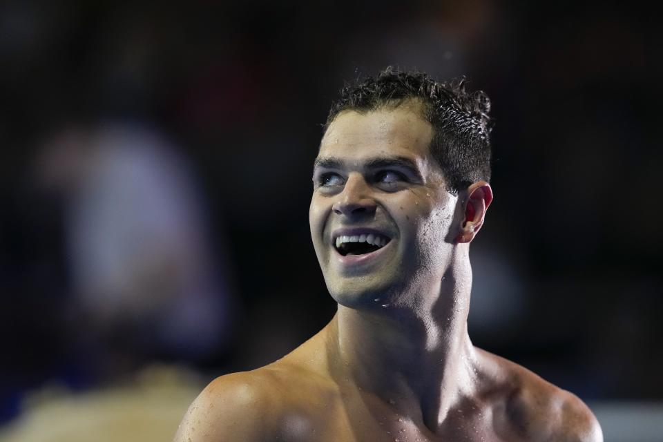 Michael Andrew reacts after winning the Men's 100 Breaststroke during wave 2 of the U.S. Olympic Swim Trials on Monday, June 14, 2021, in Omaha, Neb. (AP Photo/Charlie Neibergall)