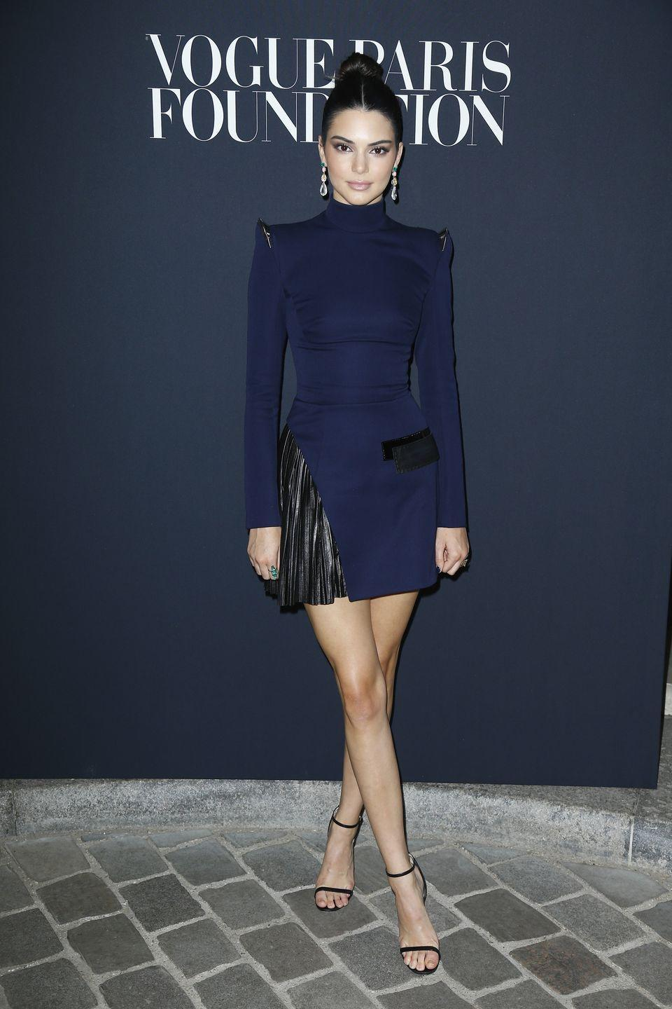 <p>The 21-year-old stunned in a black and navy, high-collared number at the Vogue Foundation Dinner in Paris</p>