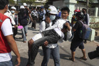 A wounded protester is carried during a protest against the military coup in Mandalay, Myanmar, Sunday, Feb. 28, 2021. Security forces in Myanmar used lethal force as they intensified their efforts to break up protests a month after the military staged a coup. At least four people were reportedly killed on Sunday. (AP Photo)