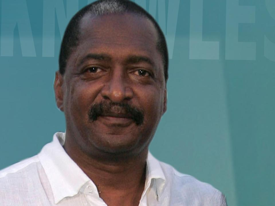 Mathew Knowles headshot, father and manager of singer Beyonce Knowles, on texture, partial graphic