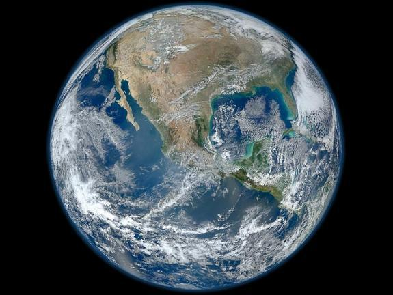 "A ""Blue Marble"" image of the Earth taken from the VIIRS instrument aboard NASA's Earth-observing satellite — Suomi NPP. This composite image uses a number of swaths of the Earth's surface taken on Jan. 4, 2012."