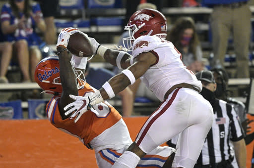Florida wide receiver Justin Shorter, left, catches a pass in the end zone for a 21-yard touchdown in front of Arkansas defensive back Jalen Catalon during the first half of an NCAA college football game Saturday, Nov. 14, 2020, in Gainesville, Fla. (AP Photo/Phelan M. Ebenhack)
