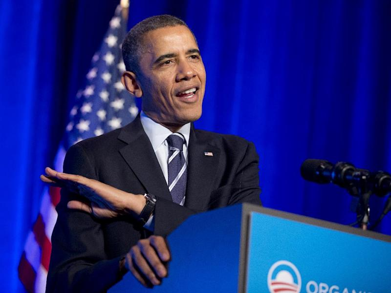 President Barack Obama gestures to describe the height of his daughters as he speaks at an Organizing for Action event in Washington, Monday, Nov. 4, 2013. (AP Photo/Manuel Balce Ceneta)