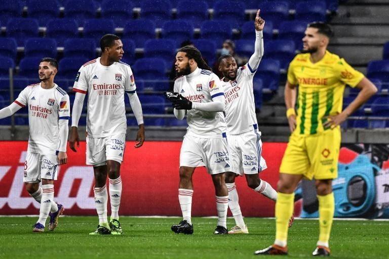 Ekambi (C) put Lyon in front in the fourth minute