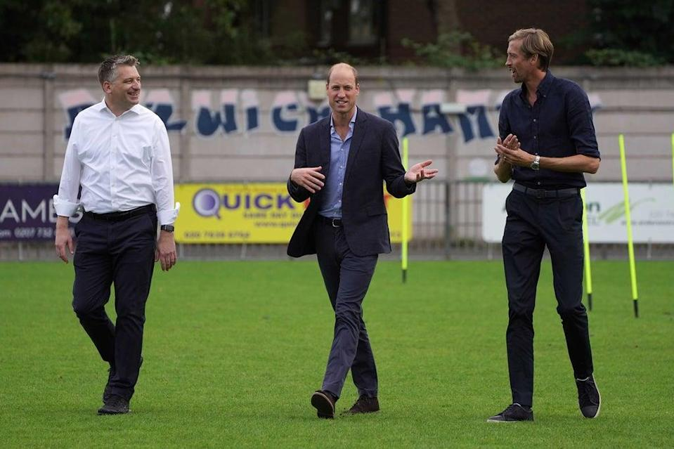 The Duke of Cambridge (centre) with Ben Clasper, chairman of Dulwich Hamlet Football Club (left) and Peter Crouch during his visit to the London club (Kirsty O'Connor/PA) (PA Wire)