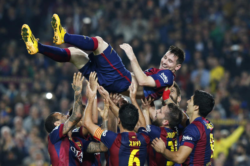 Barcelona's Lionel Messi celebrates his second goal with teammates during their Spanish first division soccer match against Sevilla at Nou Camp stadium in Barcelona November 22, 2014. Barcelona forward Messi set a La Liga scoring record of 253 goals when he claimed a hat-trick in Saturday's match at home to Sevilla. REUTERS/Gustau Nacarino (SPAIN - Tags: SPORT SOCCER TPX IMAGES OF THE DAY)