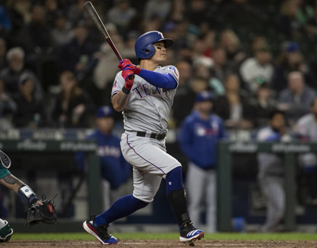 Texas Rangers' Shin-Soo Choo hits a solo home run off of Seattle Mariners Anthony Swarzak during the ninth inning of a baseball game, Friday, April 26, 2019, in Seattle. (AP Photo/Stephen Brashear)