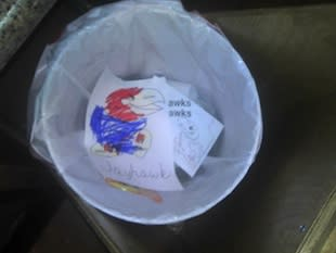 Emma Burton's reluctant Jayhawk coloring in the family trash can — Lost Lettermen via Bug Bytes