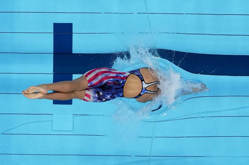 Katie Ledecky, of the United States, starts in the women's 1500-meters freestyle finalat the 2020 Summer Olympics, Wednesday, July 28, 2021, in Tokyo, Japan. (AP Photo/Morry Gash)