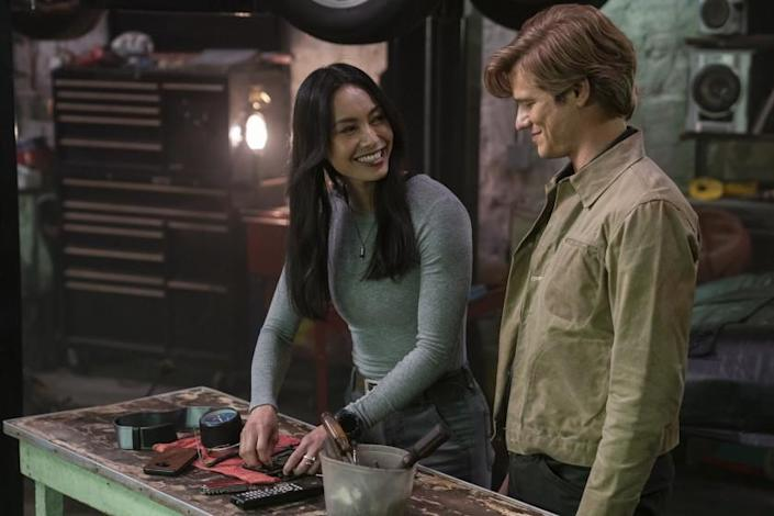 """MacGyver -- CBS TV Series, """"Barn Find + Oil Slick + La Punzonatura + Lab Rats + Tachometer"""" - While Mac and the team delve into the world of Italian car culture in order to track down a crime boss-in-hiding, Mac must lean on Desi when he discovers that he losing the ability to control his hands. Also, Mac and Desi move in together and Riley reveals the truth about her secret team of hackers to Russ, on MACGYVER, Friday, April 9 (8:00-9:00 PM, ET/PT) on the CBS Television Network. Pictured: Levy Tran as Desi Nguyen, Lucas Till as Angus """"Mac"""" MacGyver. Photo: Nathan Bolster/CBS ©2021 CBS Broadcasting, Inc. All Rights Reserved. Levy Tran and Lucas Till in """"MacGyver"""" on CBS."""
