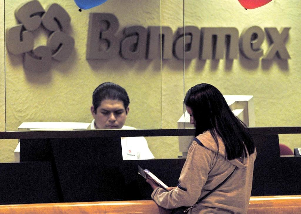 Citigroup affiliate Banamex settled a criminal investigation into its weak anti-money laundering practices and will forfeit $97.4 million. (AFP Photo/RAMON CAVALLO)
