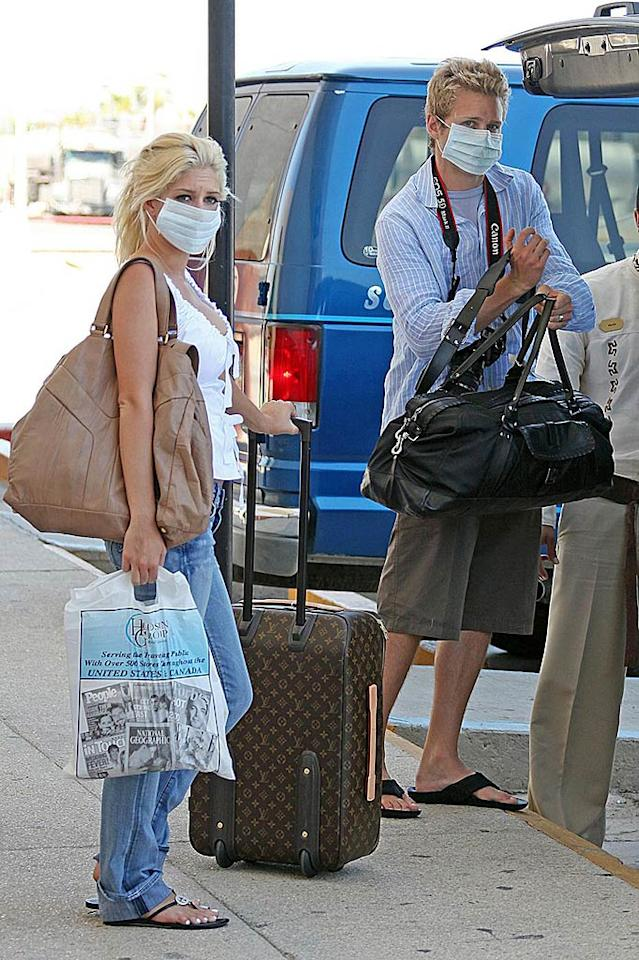 "Another reality couple -- Heidi Montag and Spencer Pratt -- donned masks after returning from Cabo San Lucas. The newlyweds were in Mexico celebrating their nuptials and shooting Heidi's new music video during the swine flu outbreak. Max Butterworth, Kevin Perkins/<a href=""http://www. PacificCoastNews.com"" target=""new"">PacificCoastNews.com</a> - April 29, 2009"