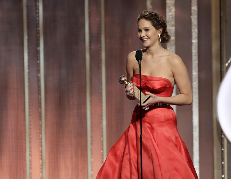 "This image released by NBC shows actress Jennifer Lawrence with her award for best actress in in a motion picture comedy or musical for her role in ""Silver Linings Playbook"" during the 70th Annual Golden Globe Awards at the Beverly Hilton Hotel on Jan. 13, 2013, in Beverly Hills, Calif. (AP Photo/NBC, Paul Drinkwater)"