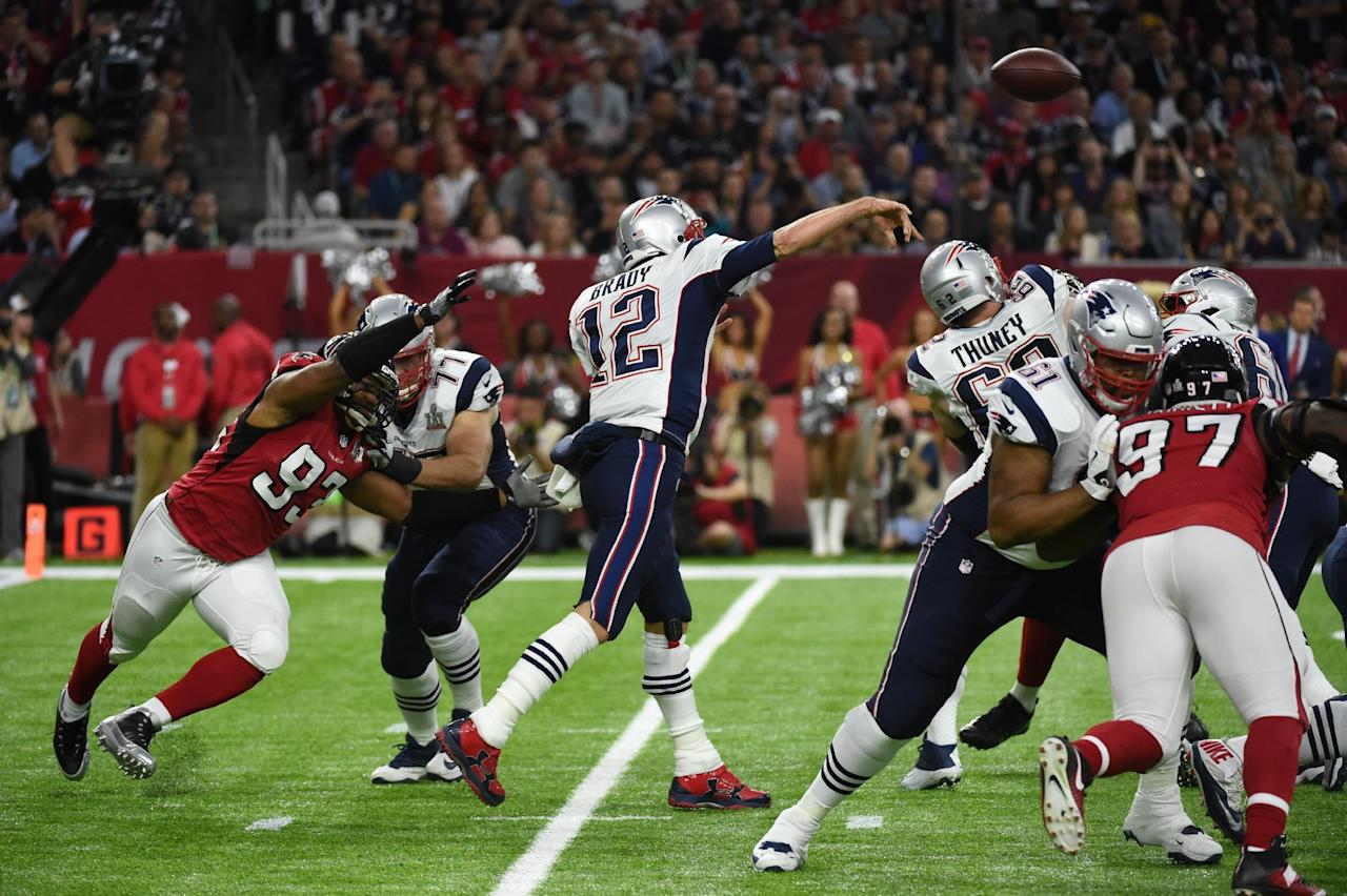 Tom Brady (12) of the Patriots passes during Super Bowl LI between the New England Patriots and the Atlanta Falcons at NGR Stadium in Houston, Texas, on February 5, 2017. (AFP Photo/Timothy A. CLARY                  )