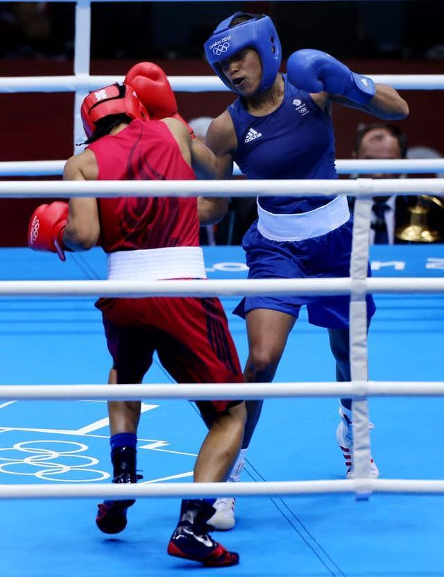 Jonas (right) became the first British female boxer to compete at the Olympics at London 2012 (Nick Potts/PA).