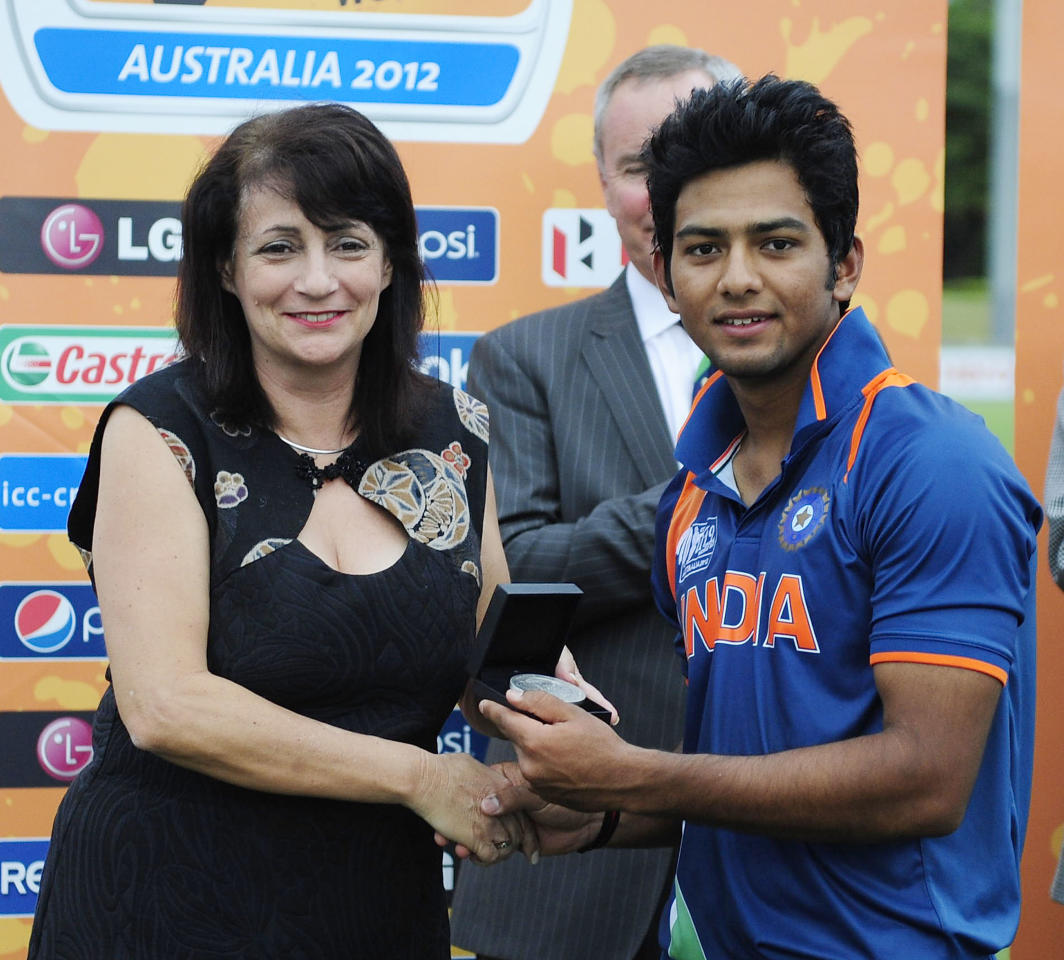 TOWNSVILLE, AUSTRALIA - AUGUST 26:  Unmukt Chand of India is presented with the player of the match award during the 2012 ICC U19 Cricket World Cup Final between Australia and India at Tony Ireland Stadium on August 26, 2012 in Townsville, Australia.  (Photo by Ian Hitchcock-ICC/Getty Images)
