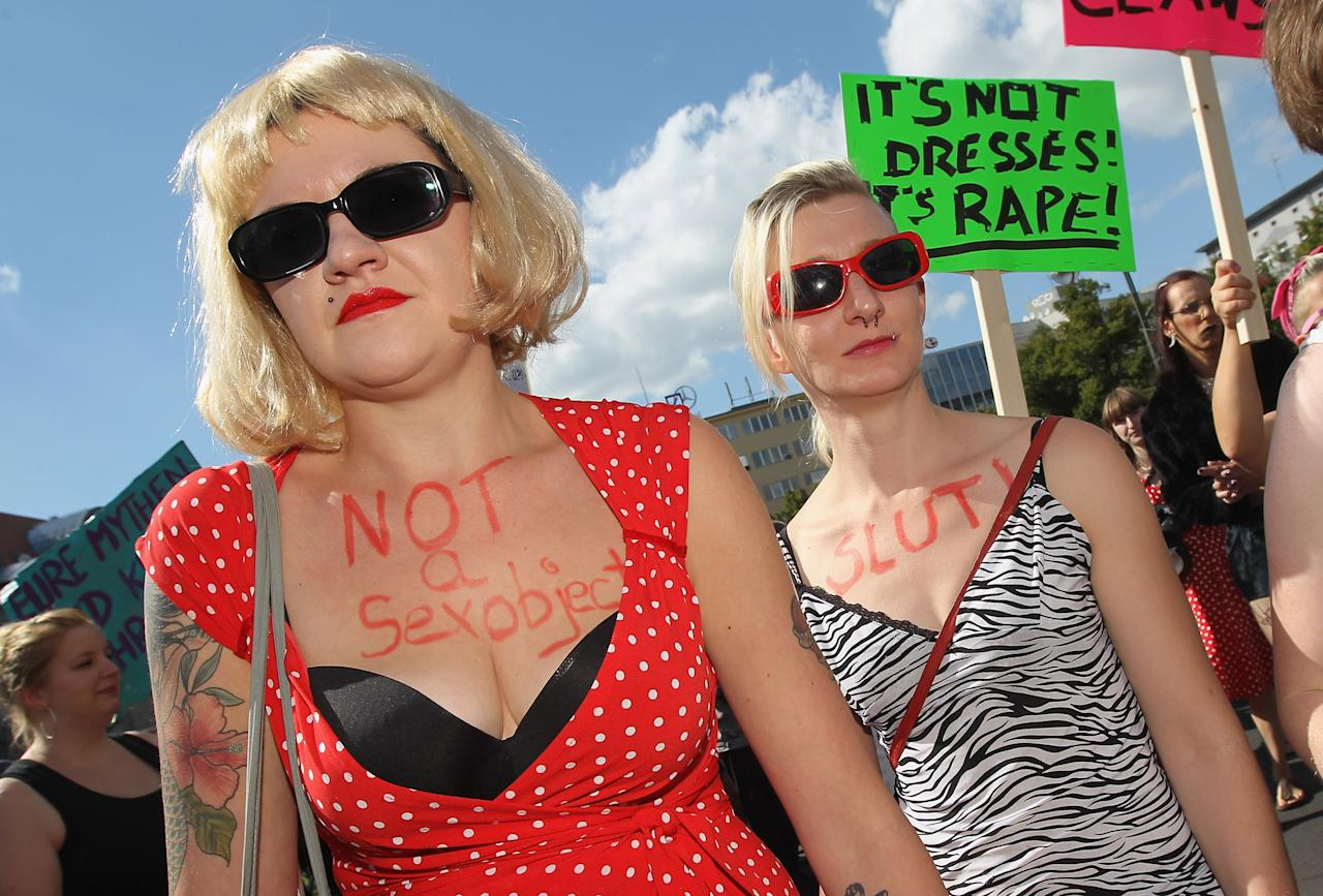 "BERLIN, GERMANY - AUGUST 13:  Women participate in the ""Slut Walk"" march on August 13, 2011 in Berlin, Germany. Several thousand men and women turned out to protest against rape and a woman's right to her body.  (Photo by Sean Gallup/Getty Images)"