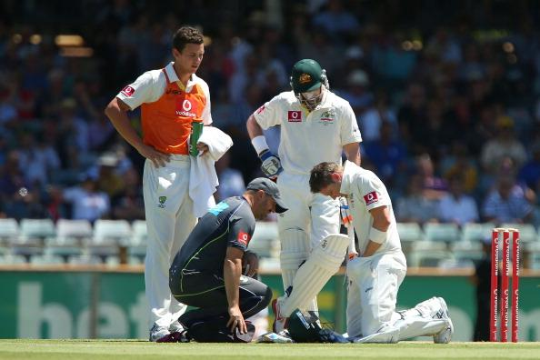 PERTH, AUSTRALIA - DECEMBER 03:  Michael Clarke of Australia inspects his groin after getting struck by the ball as Michael Hussey and team physiotherapist Alex Kountouris look on during day four of the Third Test Match between Australia and South Africa at WACA on December 3, 2012 in Perth, Australia.  (Photo by Paul Kane/Getty Images)