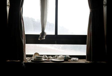 Light bulbs, bowls and plates lie on a windowsill at the abandoned Alps Ski Resort located near the demilitarised zone separating the two Koreas in Goseong, South Korea, January 17, 2018. REUTERS/Kim Hong-Ji