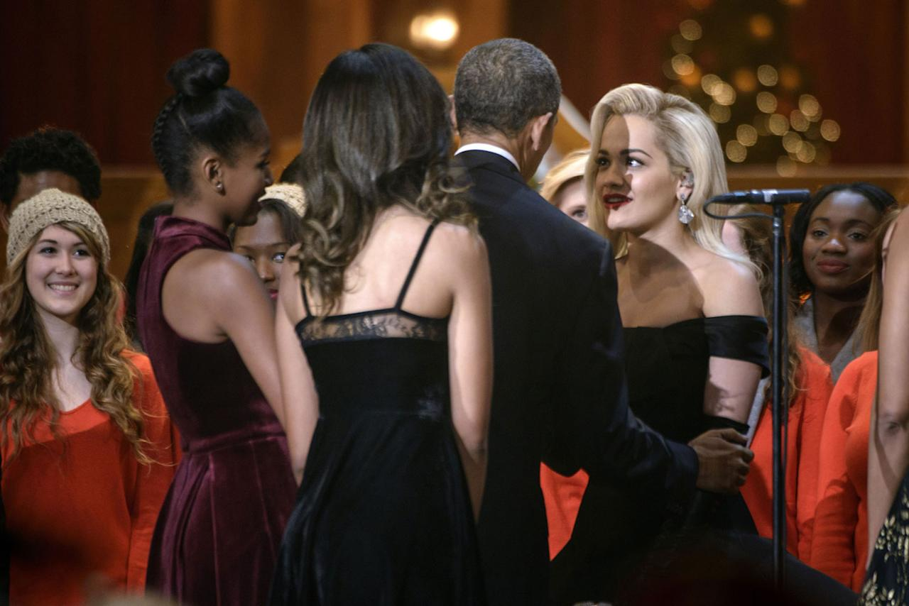 "<p>Obama and his daughters, Malia and Sasha, chat with Rita Ora during the 2014 <a rel=""nofollow"" href=""https://www.youtube.com/watch?v=Q_k-4Vf7LNg"">""Christmas in Washington""</a> concert at the National Building Museum.</p>"