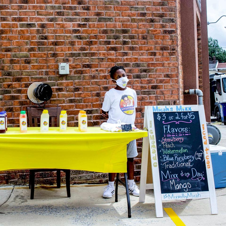 "<div class=""caption"">The man behind the lemonade stand</div><cite class=""credit"">Photo by A Brilliant Dummy / Tiayrra Bradley</cite>"