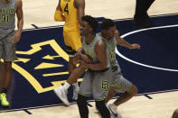 Baylor guards Adam Flagler and Jared Butler (12) celebrate the team's win over West Virginia in an NCAA college basketball game Tuesday, March 2, 2021, in Morgantown, W.Va. (AP Photo/Kathleen Batten)