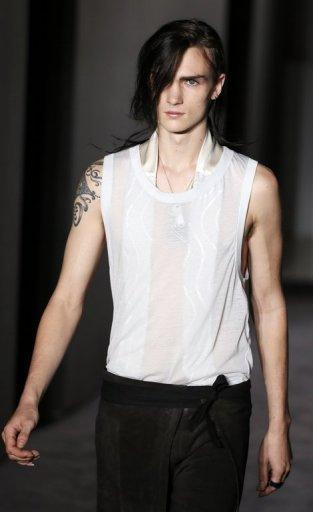 A model presents a creation by Martin Margiela during the men's spring/summer 2014 ready-to-wear fashion show on June 28, 2013 in Paris