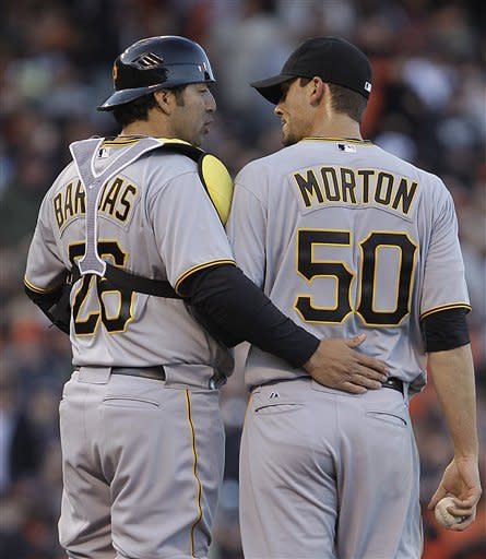 Pittsburgh Pirates pitcher Charlie Morton (50) speaks with catcher Rod Barajas during the second inning of a baseball game against the San Francisco Giants Saturday, April 14, 2012, in San Francisco. (AP Photo/Ben Margot)