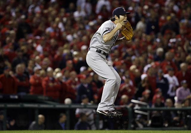 Boston Red Sox relief pitcher Koji Uehara reacts after getting St. Louis Cardinals' Matt Holliday to fly out and end Game 5 of baseball's World Series Monday, Oct. 28, 2013, in St. Louis. The Red Sox won 3-1 to take a 3-2 lead in the series. (AP Photo/Jeff Roberson)
