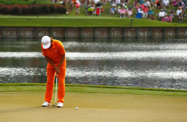 PONTE VEDRA BEACH, FL - MAY 13: Rickie Fowler of the United States putts on the 16th hole during the final round of THE PLAYERS Championship held at THE PLAYERS Stadium course at TPC Sawgrass on May 13, 2012 in Ponte Vedra Beach, Florida. (Photo by Mike Ehrmann/Getty Images)