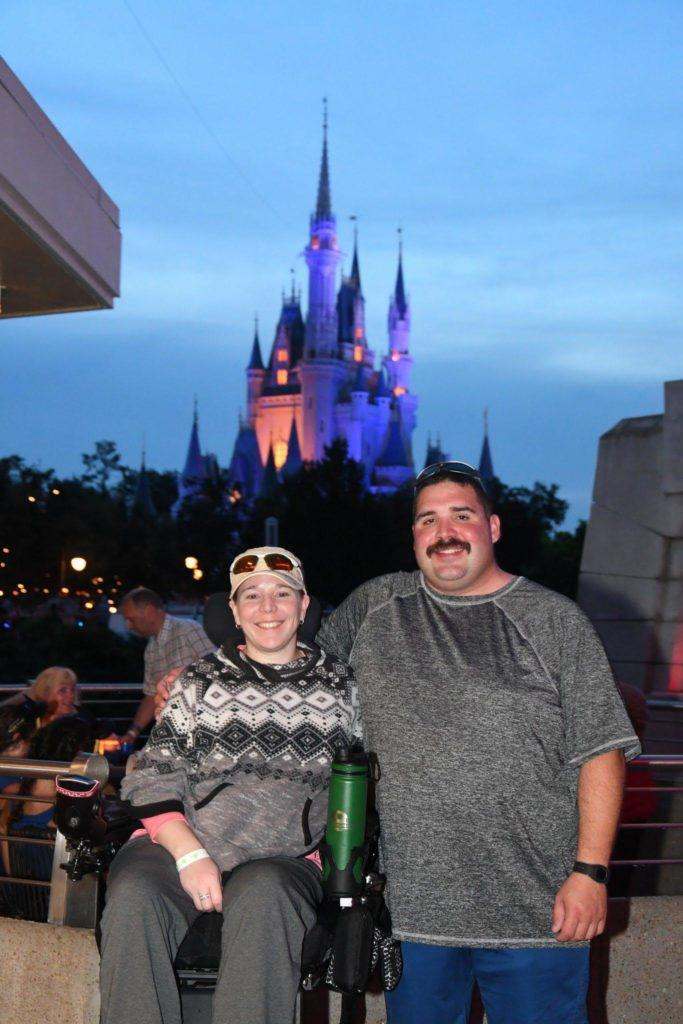 My husband and I at Walt Disney World waiting to watch the fireworks with the Castle in the background.