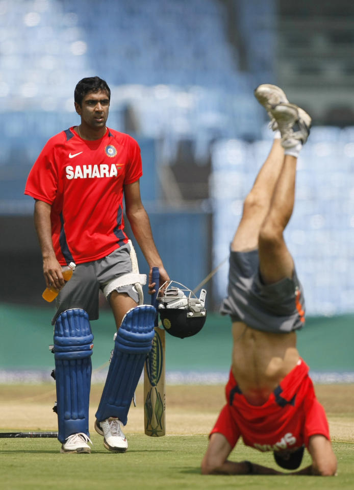 India's Ravichandran Ashwin, left, walks towards the team's mental conditioning coach Paddy Upton, right, during a practice session ahead of the International Cricket Council (ICC) Cricket World Cup in Chennai, India, Tuesday, Feb. 15, 2011. The ICC Cricket World Cup will begin on Feb. 19.