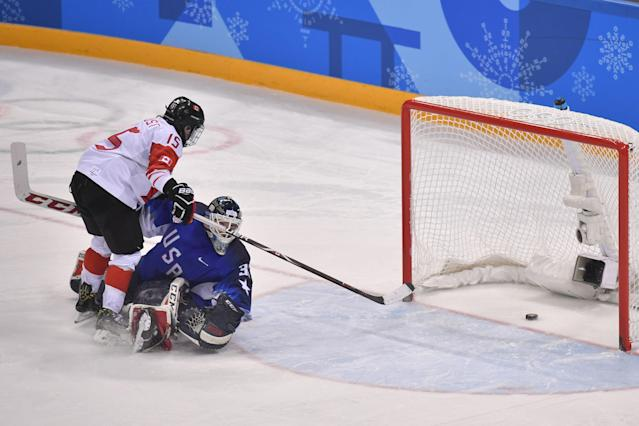 <p>Canada's Melodie Daoust (L) scores a goal in the penalty shoot out in the women's gold medal ice hockey match between Canada and the US during the Pyeongchang 2018 Winter Olympic Games at the Gangneung Hockey Centre in Gangneung on February 22, 2018. / AFP PHOTO / Ed JONES </p>