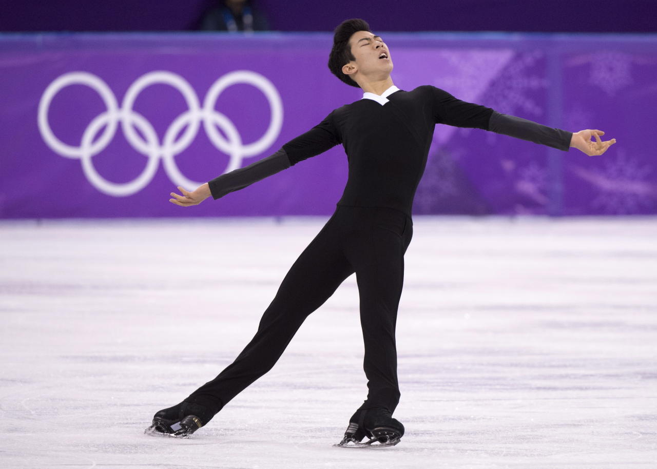 FILE - In this Feb. 17, 2018, file photo, Nathan Chen competes in the men's figure skating free program at the Pyeonchang Winter Olympics, in Gangneung, South Korea. For the season following an Olympics, Skate America certainly is packed with top U.S. competitors. The six-event Grand Prix series begins in Everett, Washington on Friday, Oct. 19. (Paul Chiasson/The Canadian Press via AP, File)