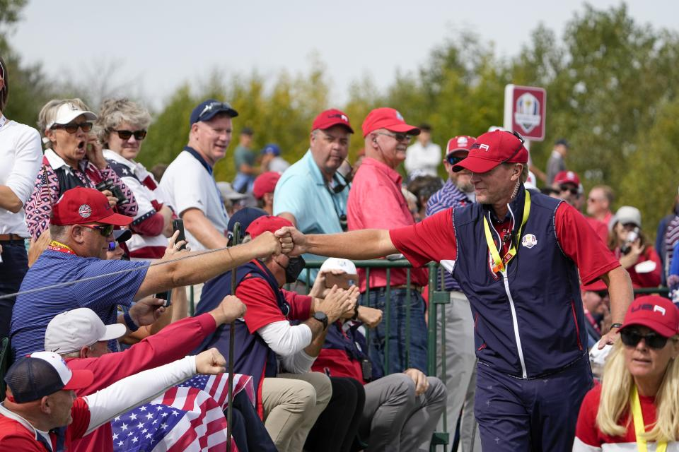 Team USA captain Steve Stricker greets fans on the second hole during a Ryder Cup singles match at the Whistling Straits Golf Course Sunday, Sept. 26, 2021, in Sheboygan, Wis. (AP Photo/Jeff Roberson)