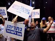 Supporters react at the Likud party headquarters following the announcement of exit polls during Israel's parliamentary election in Tel Aviv