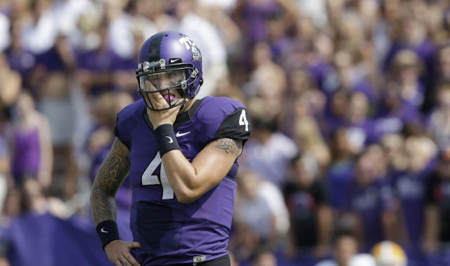 FILE - In this Sept. 7, 2013, file photo, TCU quarterback Casey Pachall (4) wipes his face while standing on the field during the first half of an NCAA college football game against Southeastern Louisiana in Fort Worth, Texas. (AP Photo/LM Otero)
