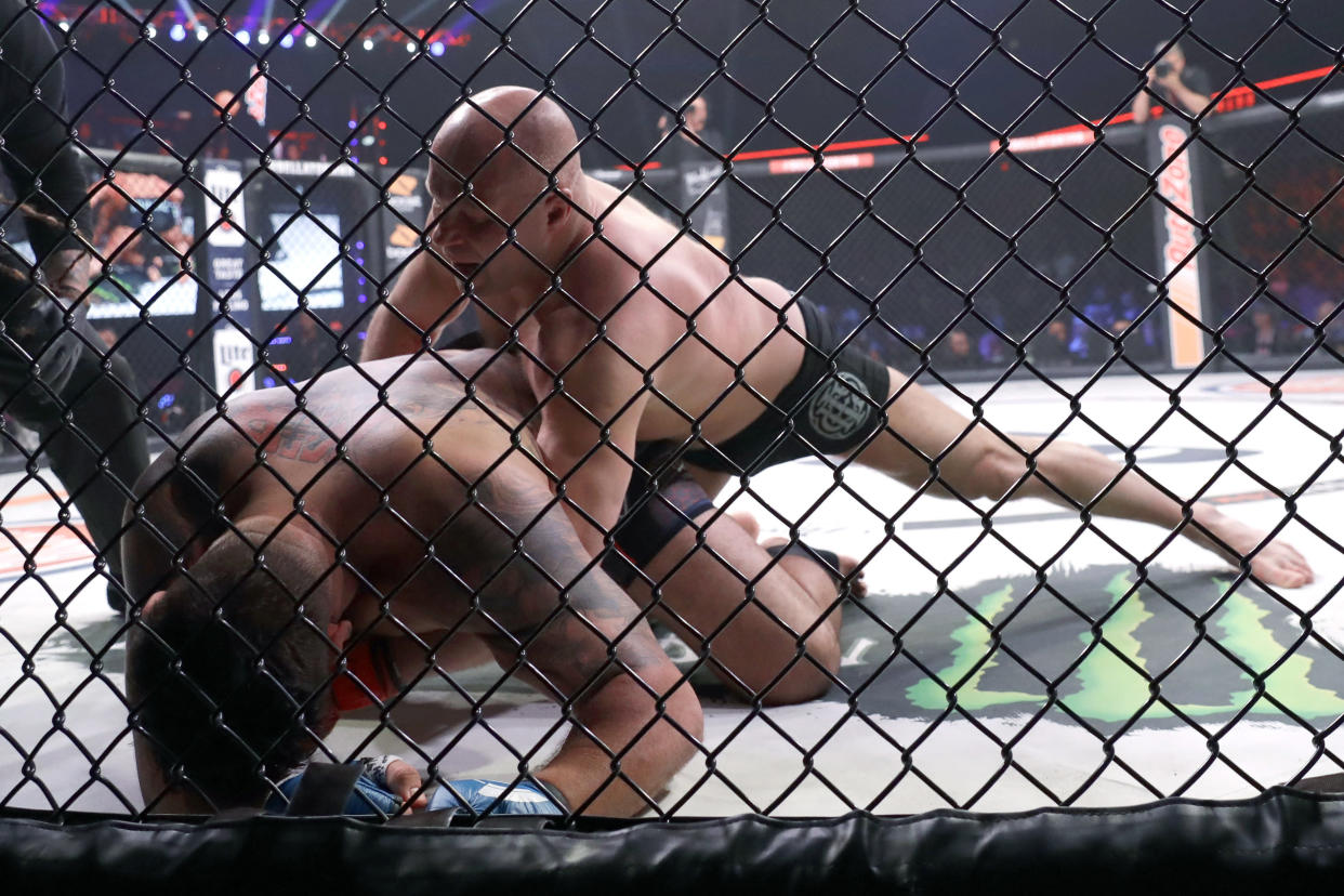 Fedor Emelianenko (R) fights Frank Mir in a heavyweight mixed martial arts bout at Bellator 198, Saturday, April 28, 2018, in Rosemont, Illinois. (AP Photo/Nam Y. Huh)