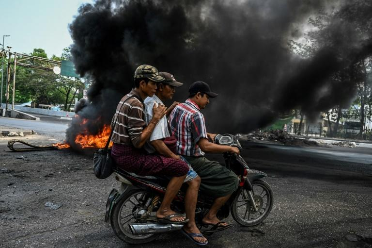 Smoke from burning barricades choked the streets of Yangon neighbourhoods where anti-coup demonstrators clashed police and soldiers